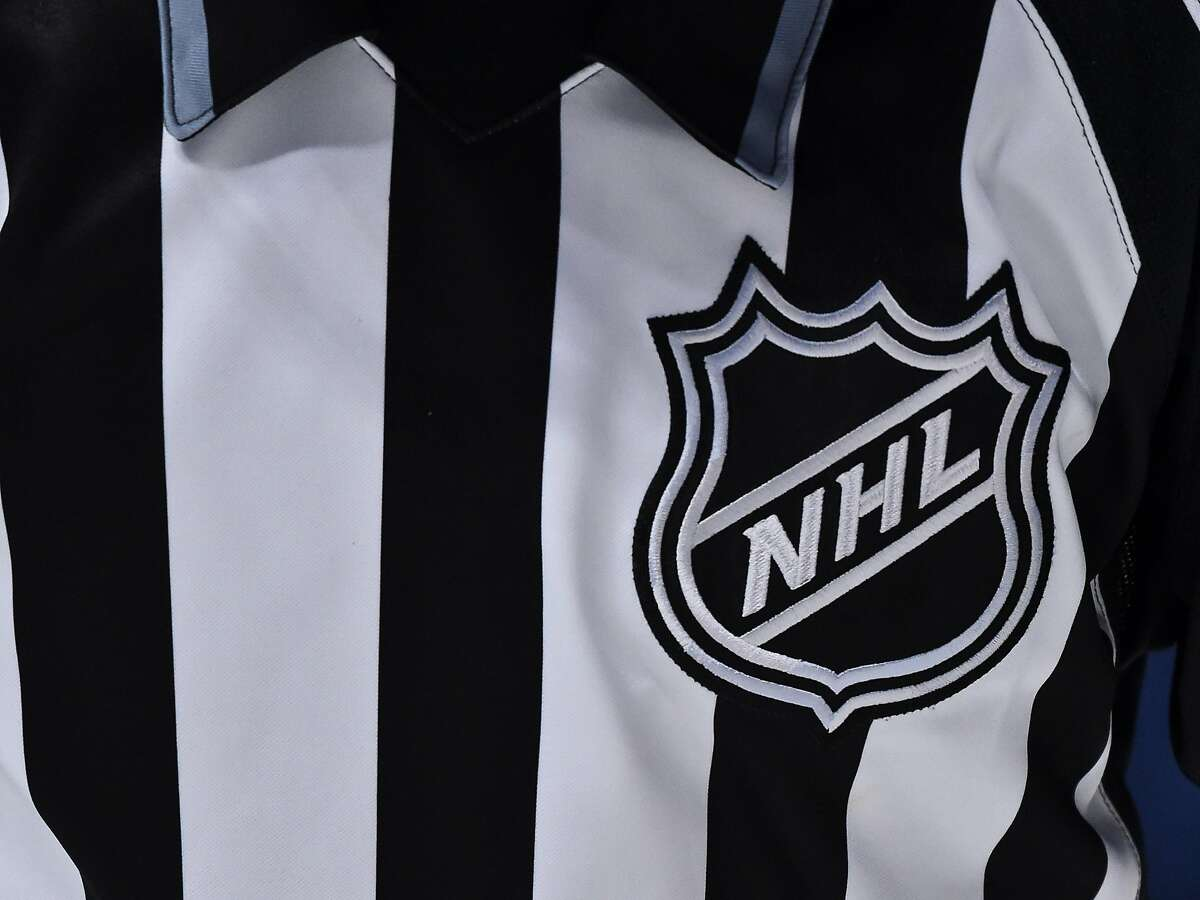 The NHL crest is seen on a linesmans jersey during a game between the Montreal Canadiens and the Ottawa Senators during the third period on Dec. 11, 2019 at the Bell Centre in Montreal, Canada. (Minas Panagiotakis/Getty Images/TNS)