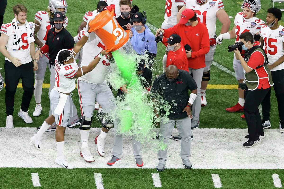 Ohio State head coach Ryan Day get soaked in a sports drink after their win against Clemson during the second half of the Sugar Bowl NCAA college football game Saturday, Jan. 2, 2021, in New Orleans.
