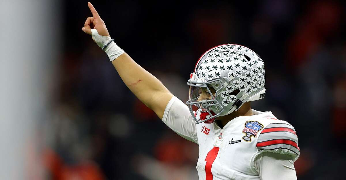 Justin Fields #1 of the Ohio State Buckeyes reacts after a touchdown against the Clemson Tigers in the third quarter during the College Football Playoff semifinal game at the Allstate Sugar Bowl at Mercedes-Benz Superdome on January 01, 2021 in New Orleans, Louisiana. (Photo by Kevin C. Cox/Getty Images)