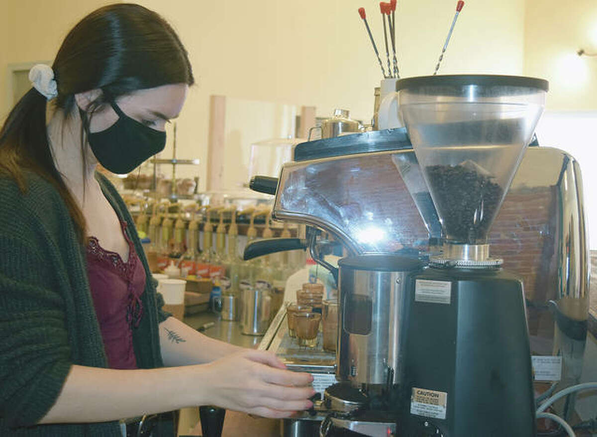 Kyra Pippin makes drinks Thursday at The Soap Co. Coffee House's new location at 207 S. Sandy St.
