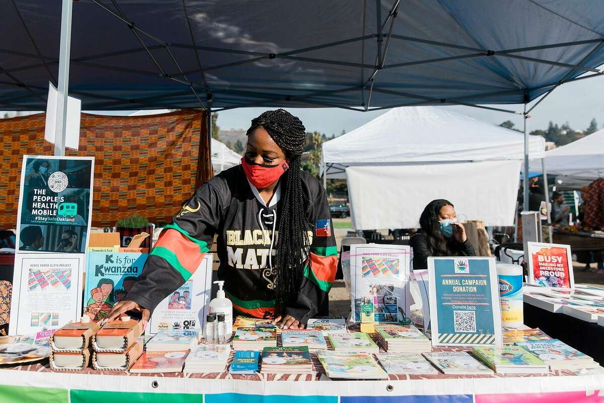Ashley Aaron sets up a booth at Oakland's Akoma Outdoor Market, which hosts Black vendors.