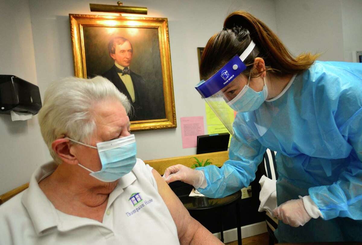 Kathleen Sawtelle, a pharmacist with Health Direct, gives Pfizer's COVID-19 vaccine to Sandy Merkle, a registered nurse, and infection preventionist for Rehabilitation & Nursing Center, in Brattleboro, Vt., on Tuesday, Dec. 29, 2020. Merkle, 81, who started her career by helping people get the polio vaccine, said she was excited to get the COVID-19 vaccine as she nears the end of her nursing career. Merkle's planned retirement got delayed, as she stayed on working to help fight the COVID-19 pandemic.