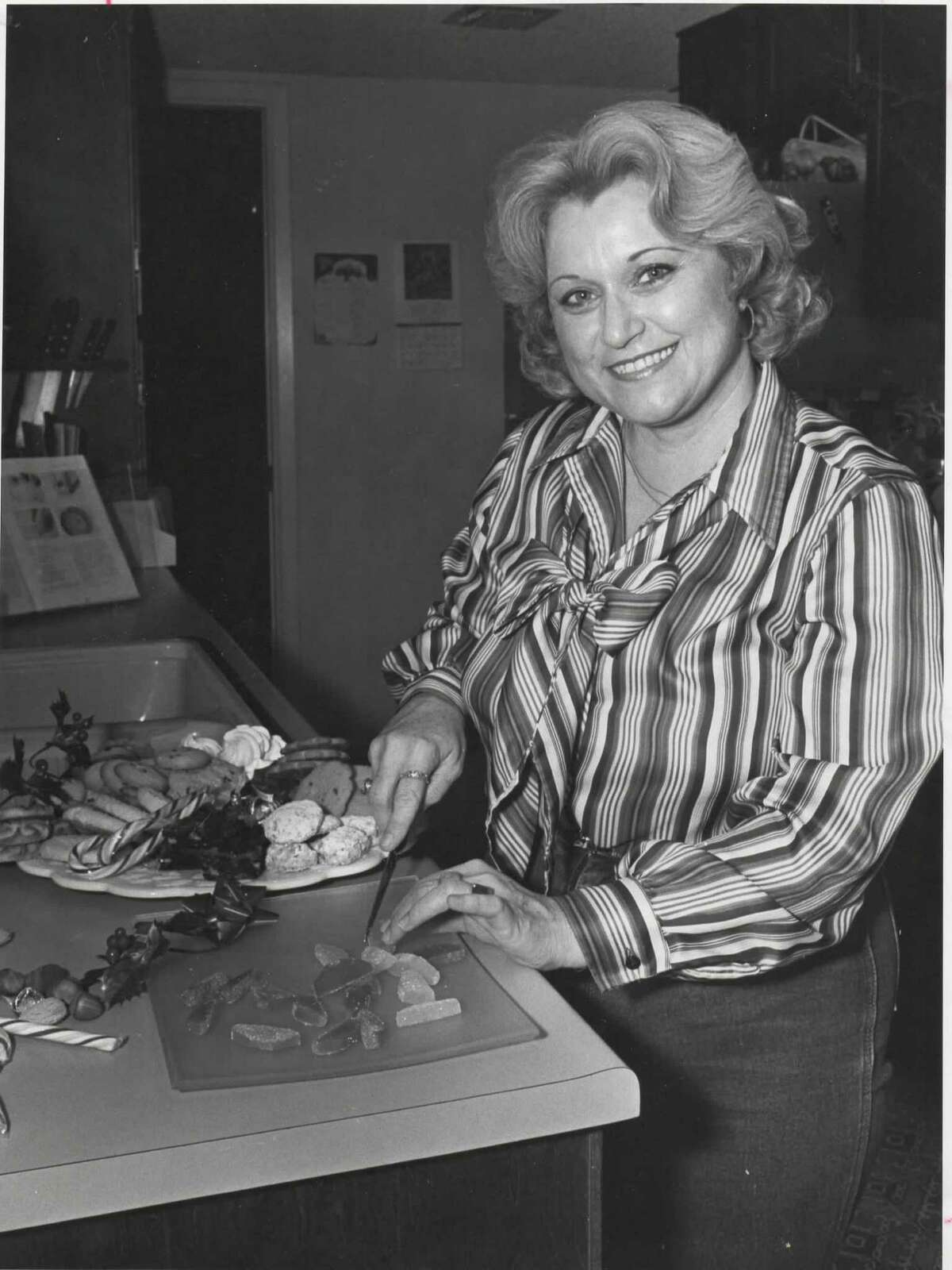 """Mary Mora is making holiday treats in her San Antonio kitchen November 23, 1982. She is the Express-News """"Best Cook on the Block."""" Mora is a coordinator at Joske's and has edited a series of cookbooklets for the department store, including """"Joske's Recipes"""" in February 1982 and """"Cook It Easy, Summer Style"""" in August 1982."""