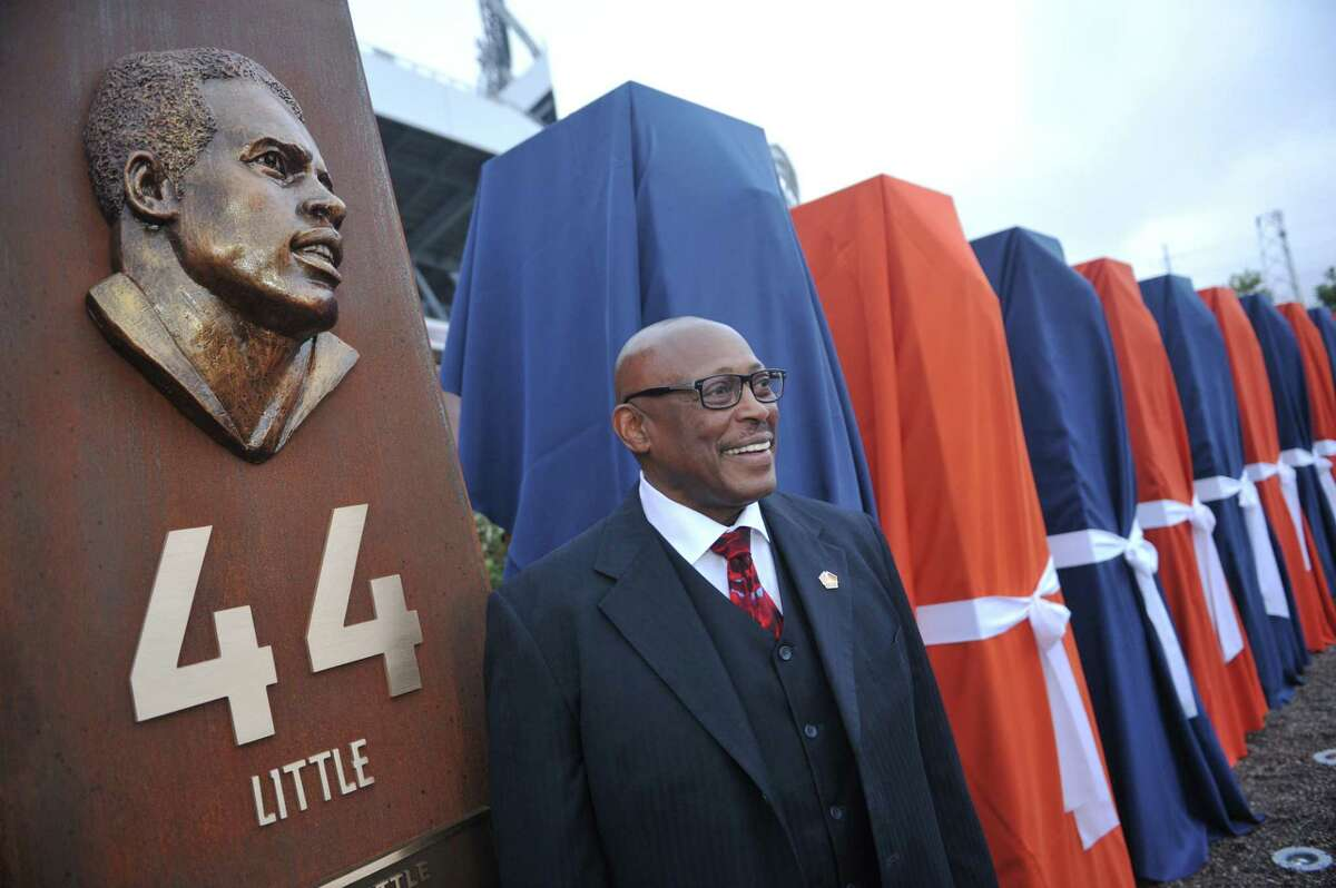 DENVER, CO - September 27 : Pro Football Hall of Fame running back Floyd Little unveiled the sculpture at the Denver Broncos Ring of Fame Plaza in Sports Authority Field at Mile High. Denver, Colorado. September 27, 2013. The Plaza feature pillars honoring each of the 24 players in the Broncos Ring of Fame. (Photo by Hyoung Chang/The Denver Post via Getty Images)