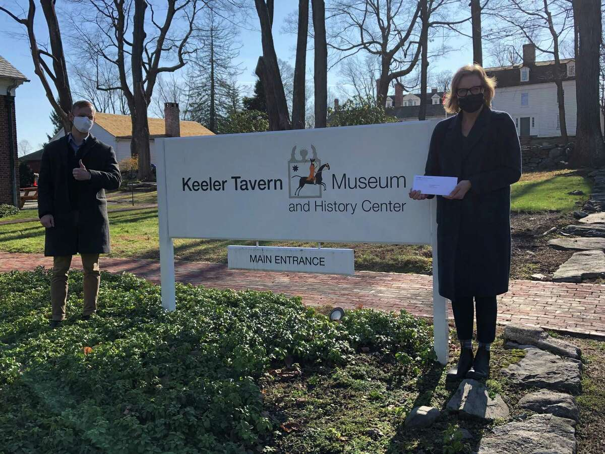 Antony Tokarr, who is the branch manager of Ridgefield's M&T Bank location in the town, recently presented the Keeler Tavern Museum and History Center's Executive Director Hildegard Grob with a $5,000 sponsorship of the Museum and History Center's history programs for a Title 1 School Students project. Pictured are: Tokarr, and Grob.
