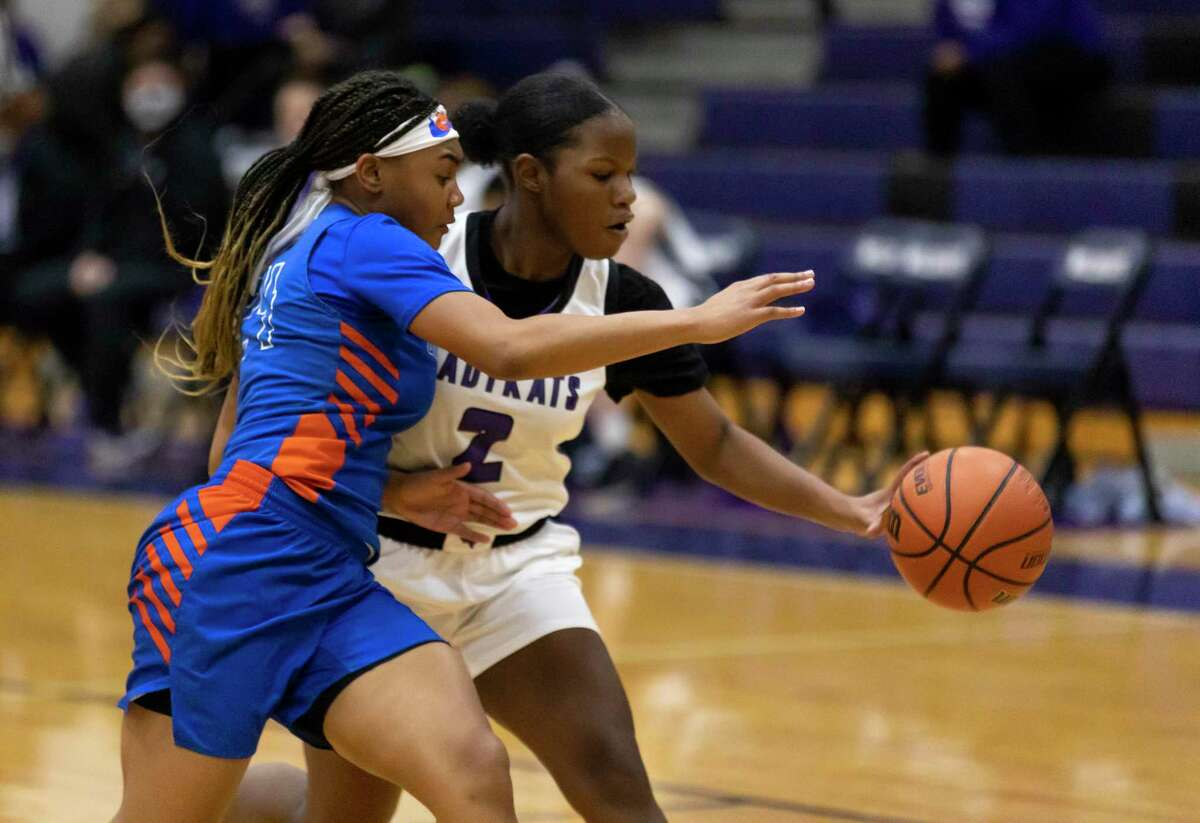 Grand Oaks shooting guard Kaitlyn Stewart (24) steals the ball from Willis guard Shemaiah Eldridge (2) during the first quarter of a District 13-6A girls basketball game at Willis High School, Saturday, Jan. 2, 2020, in Willis.