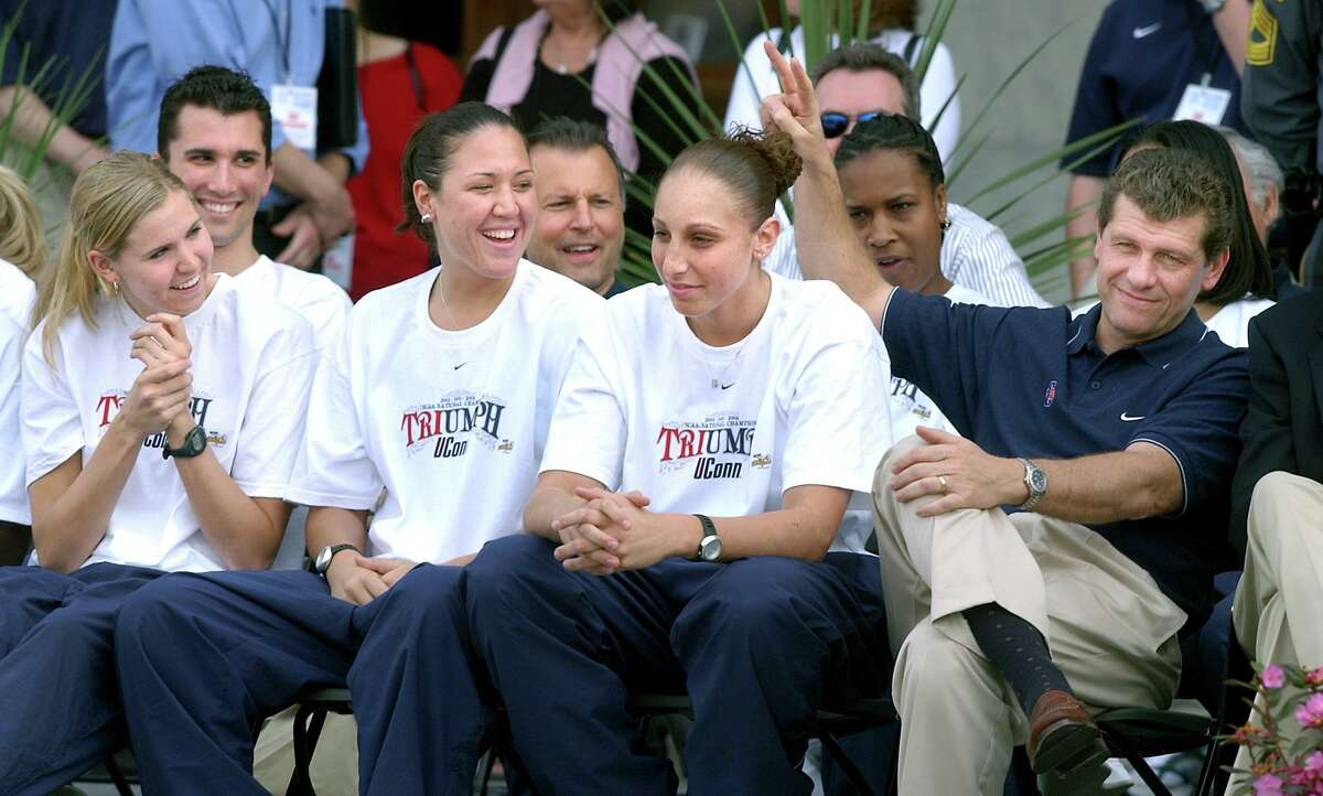 Coach Geno Auriemma, right, puts up bunny ears behind Diana Taurasi while Ann Strother, left, and Morgan Valley watch during a 2004 rally in Hartford.
