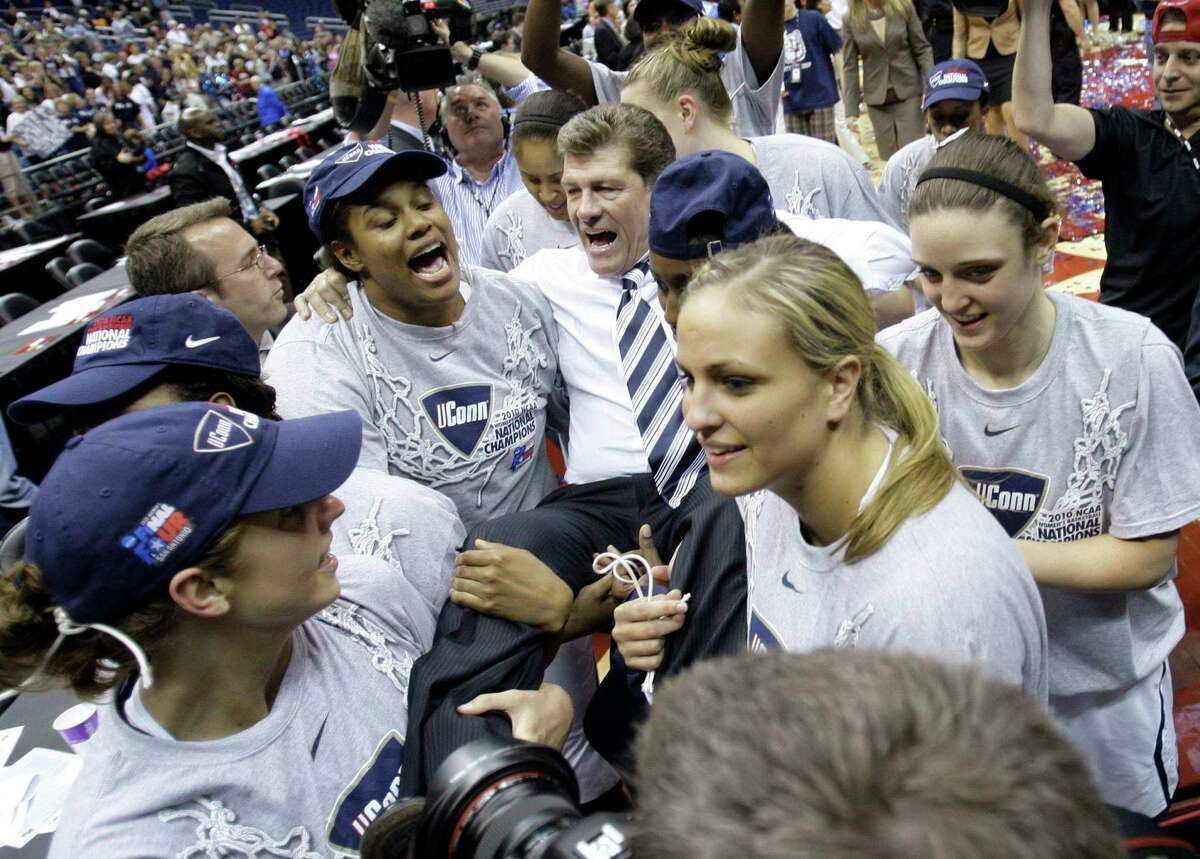 UConn players carry coach Geno Auriemma off the floor after winning the NCAA Tournament championship game against Stamford in 2010.