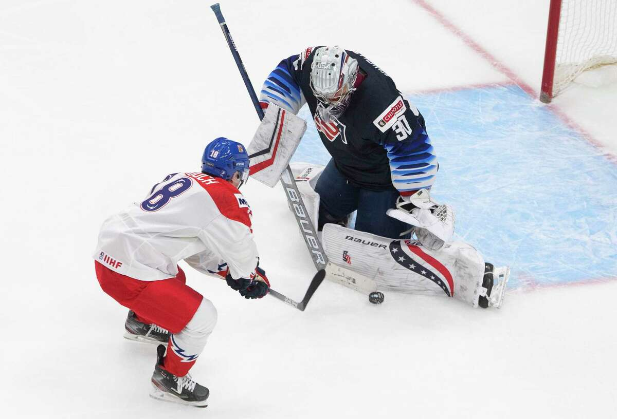 United States' goalie Spencer Knight (30) makes the save on Czech Republic's David Vitouch (18) during the third period of an IIHF World Junior Hockey Championship game in Edmonton, Alberta on Tuesday, Dec. 29, 2020.(Jason Franson/The Canadian Press via AP)