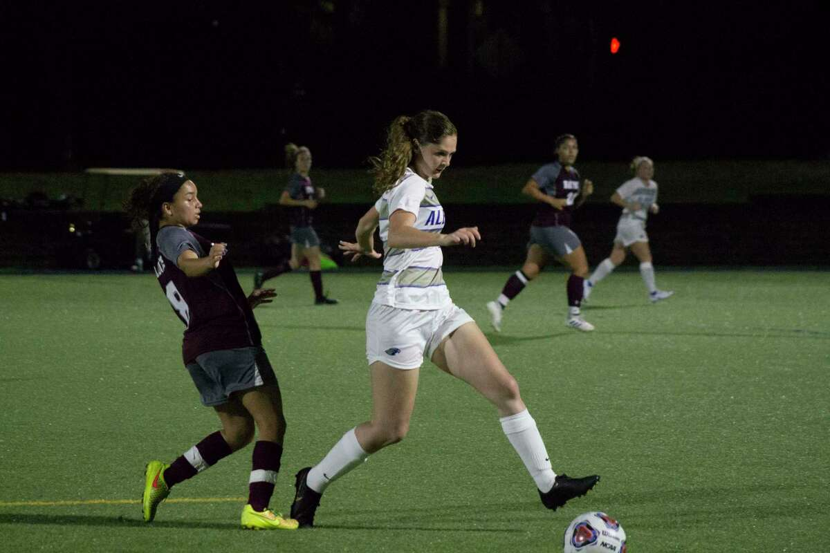 Albertus Magnus' Megan Doyle, right, may have lost her fall soccer season, but the junior has been busy advancing her career in social media marketing.