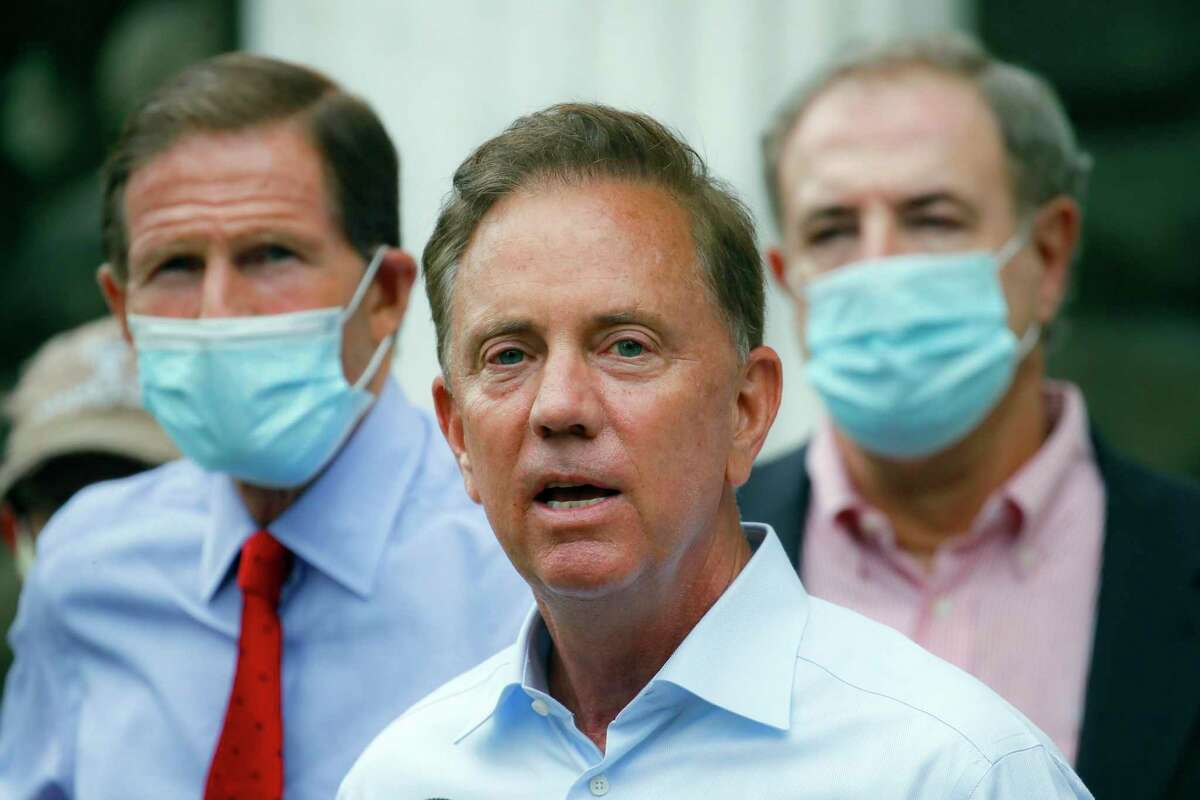 In this Aug. 7, 2020, file photo, Connecticut Gov. Ned Lamont addresses the media in Westport, Conn. On Wednesday, Nov. 25, 2020, Lamont imposed a steep new $10,000 fine on businesses that break the state's coronavirus rules. He said that the heftier fine is needed because some businesses have flagrantly violated the rules, and there are concerns for worker and customer safety during the holiday shopping season.
