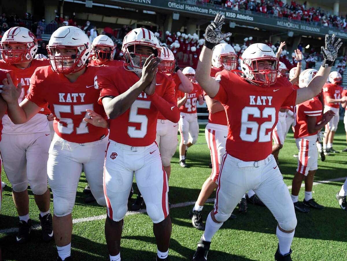 Katy's Cole Rogers (57), JaKorien Haynes (5) and Skylar Wiggins (62) celebrate the team's win over Clear Falls in the 6A Division II Region III Final high school football playoff game, Saturday, Jan. 2, 2021, in Katy, TX.