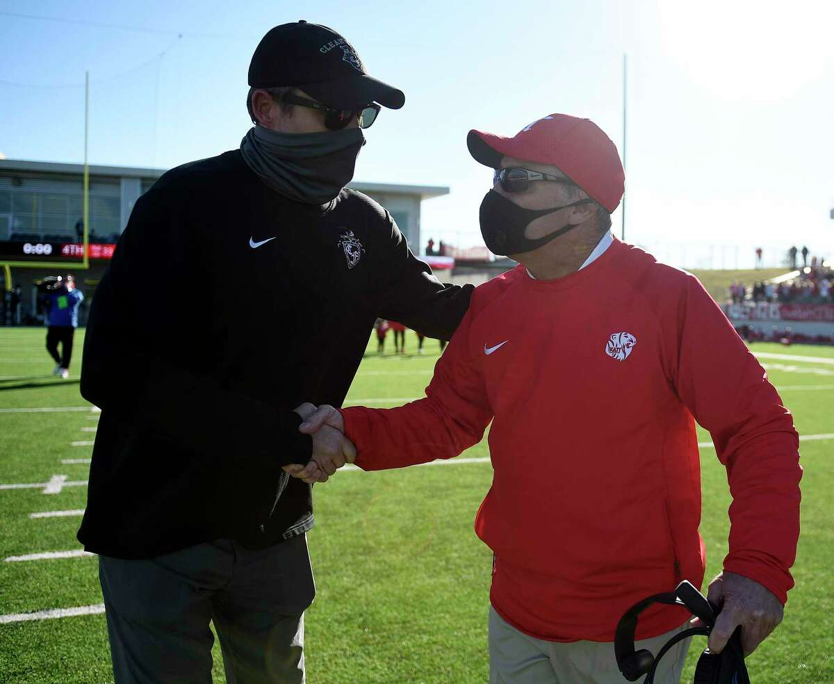 Katy head coach Gary Joseph, right, shakes hands with Clear Falls head coach Zach Head after Katy's win over Clear Falls in the 6A Division II Region III Final high school football playoff game, Saturday, Jan. 2, 2021, in Katy, TX.