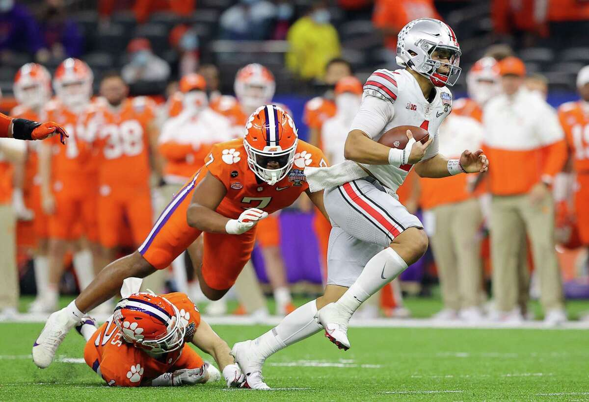 Ohio State QB Justin Fields looks to escape pressure in Friday's win over Clemson. Fields scorched the Tigers for six TD passes.