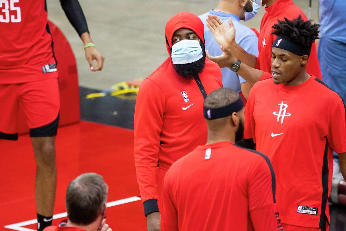 Houston Rockets guard James Harden (13) listens in the huddle before the first quarter of an NBA game between the Houston Rockets and Sacramento Kings on Saturday, Jan. 2, 2021, at Toyota Center in Houston. Harden was a late scratch from the game because of an ankle injury.