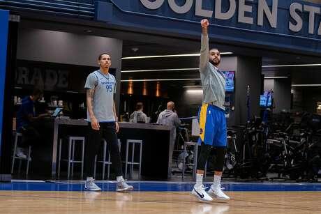 Warriors guard Mychal Mulder watches his shot on Saturday, Jan. 2, 2021, on the practice court at Chase Center in San Francisco, Calif., as teammate Juan Toscano-Anderson, left, looks on.