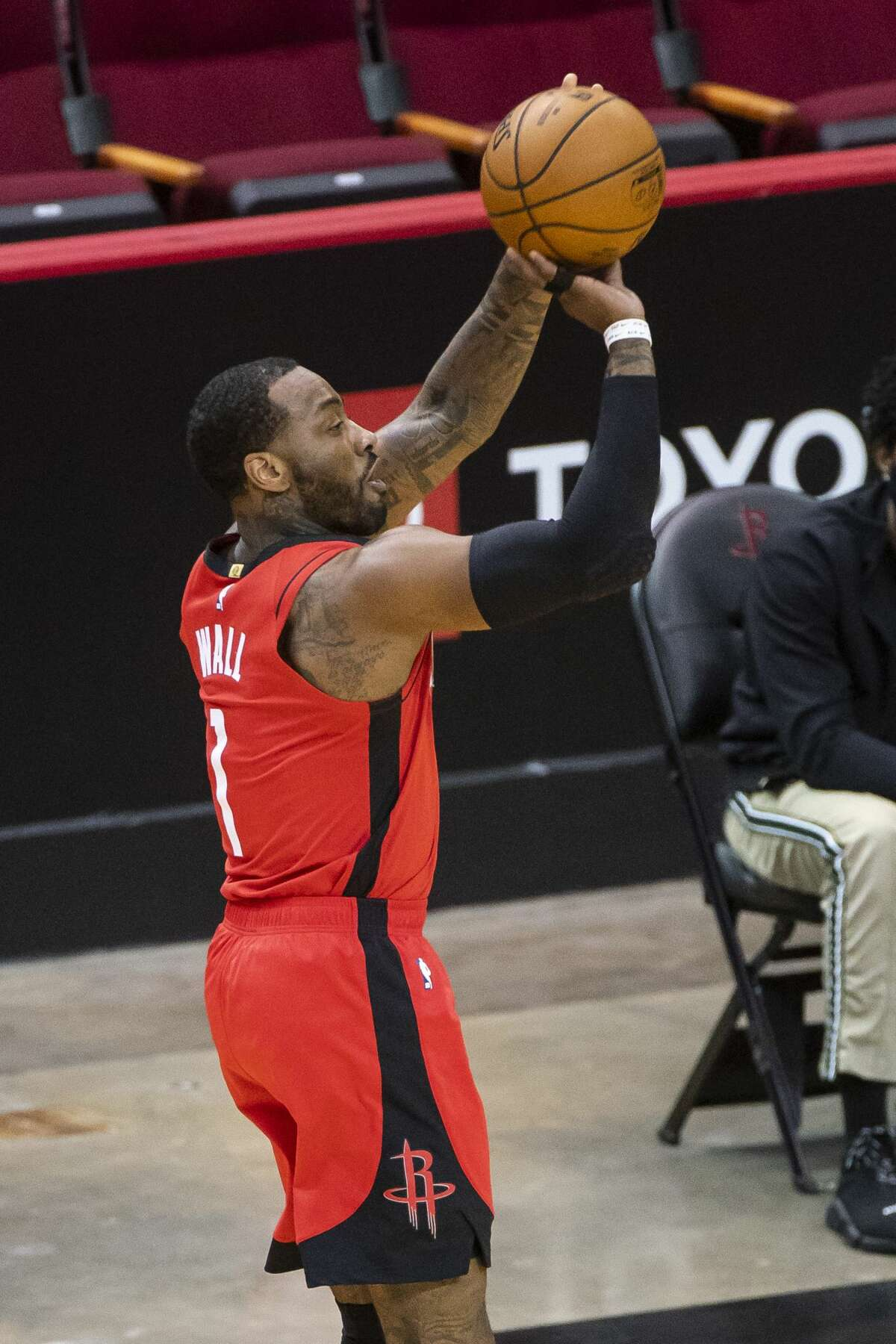 Houston Rockets guard John Wall (1) hits a three point shot during the first quarter of an NBA game between the Houston Rockets and Sacramento Kings on Saturday, Jan. 2, 2021, at Toyota Center in Houston.
