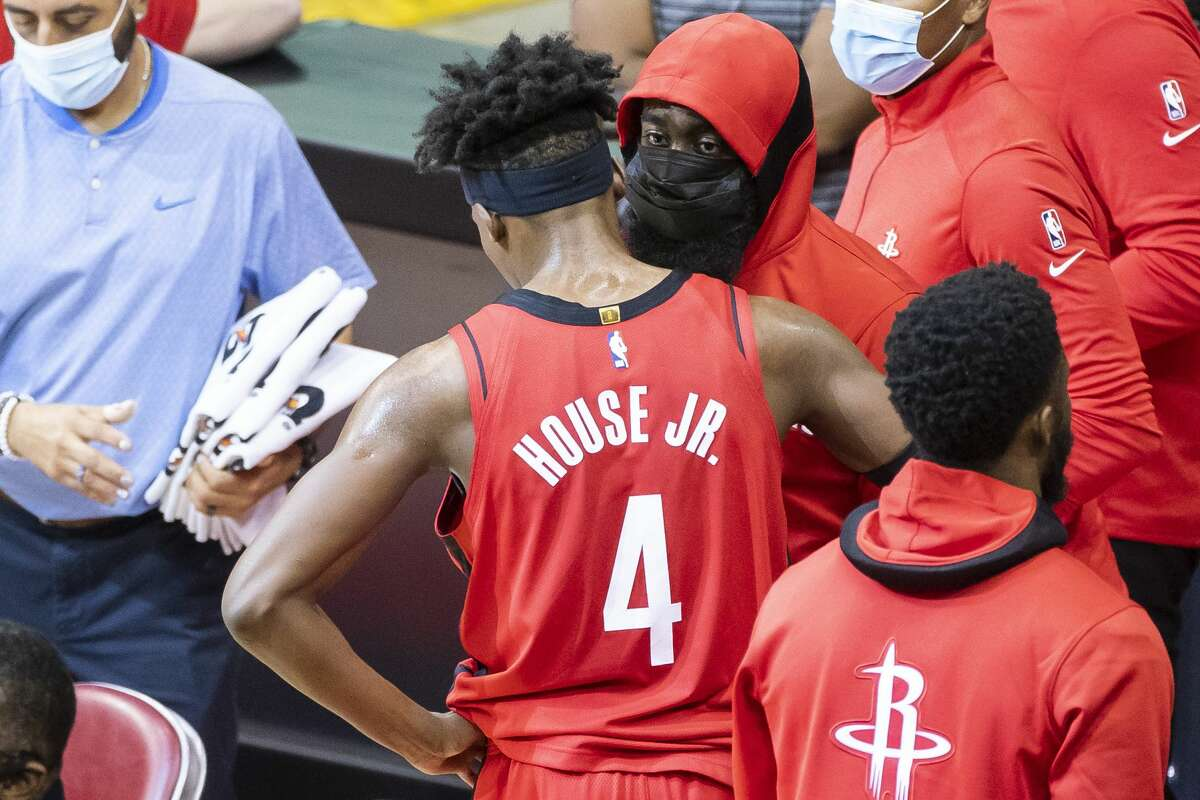Houston Rockets guard James Harden (13) talks to forward Danuel House Jr. (4) during a timeout during the second quarter of an NBA game between the Houston Rockets and Sacramento Kings on Saturday, Jan. 2, 2021, at Toyota Center in Houston.