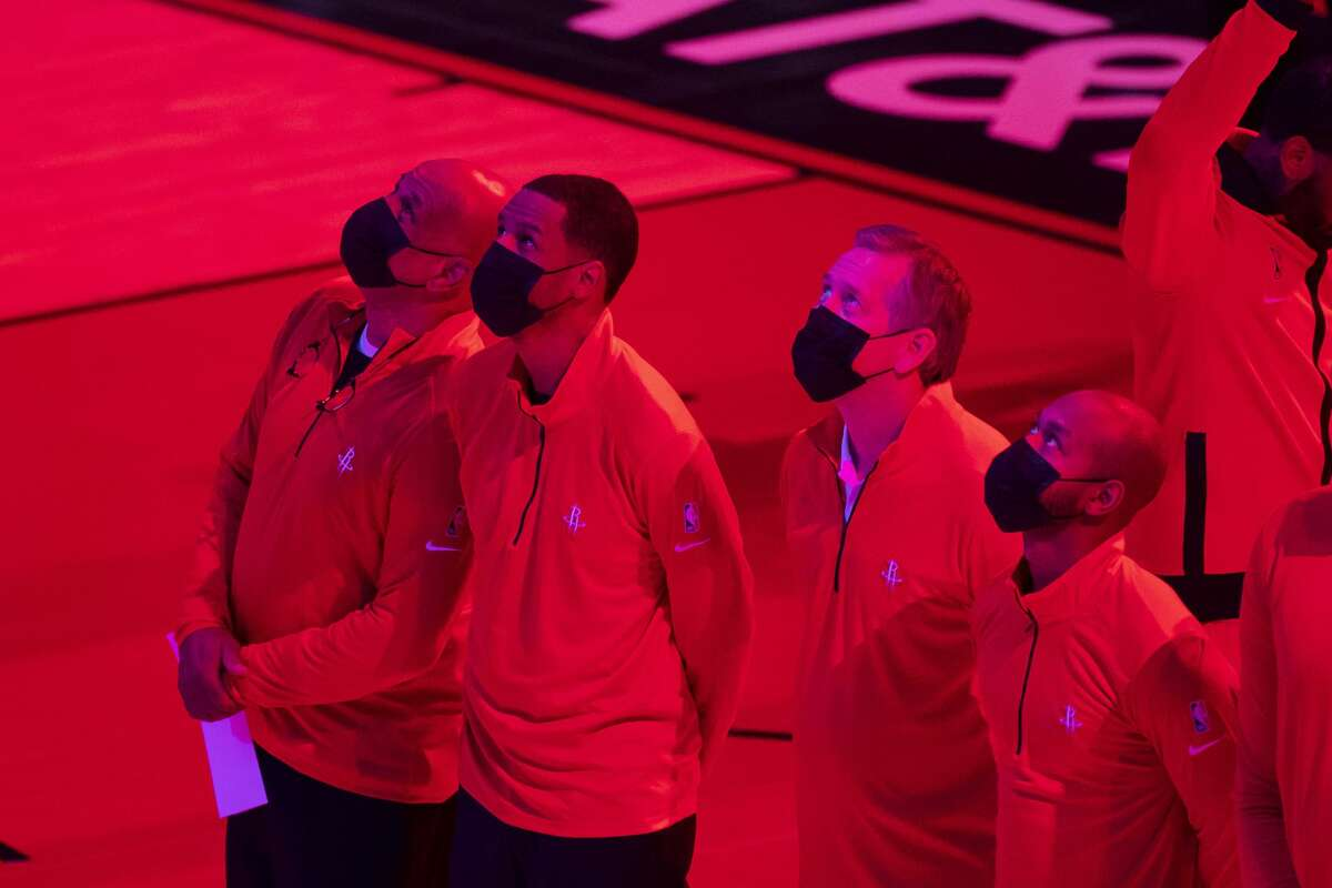 Houston Rockets head coach Stephen Silas watches as his daughters sing the National Anthem before the first quarter of an NBA game between the Houston Rockets and Sacramento Kings on Saturday, Jan. 2, 2021, at Toyota Center in Houston.