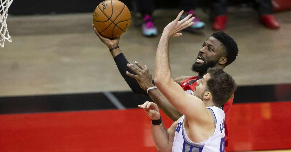 Houston Rockets guard David Nwaba (2) shoots past Sacramento Kings forward Nemanja Bjelica (8) during the fourth quarter of the Houston Rockets 102-94 win over the Sacramento Kings on Saturday, Jan. 2, 2021, at Toyota Center in Houston.