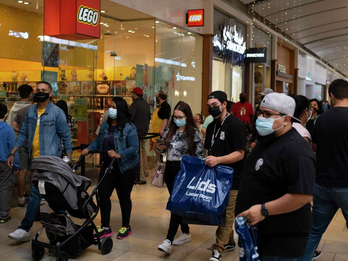 Holiday shoppers make their way through North Park Mall with stores imposing Coronavirus restrictions on Saturday, December 12, 2020 in San Antonio, Tx., U.S.