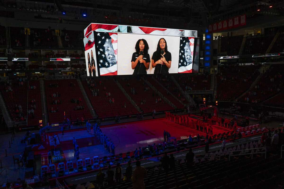 In a recording, Rockets head coach Stephen Silas' daughters, Ky and Kae, sing the National Anthem before the Houston Rockets 102-94 win over the Sacramento Kings on Saturday, Jan. 2, 2021, at Toyota Center in Houston.