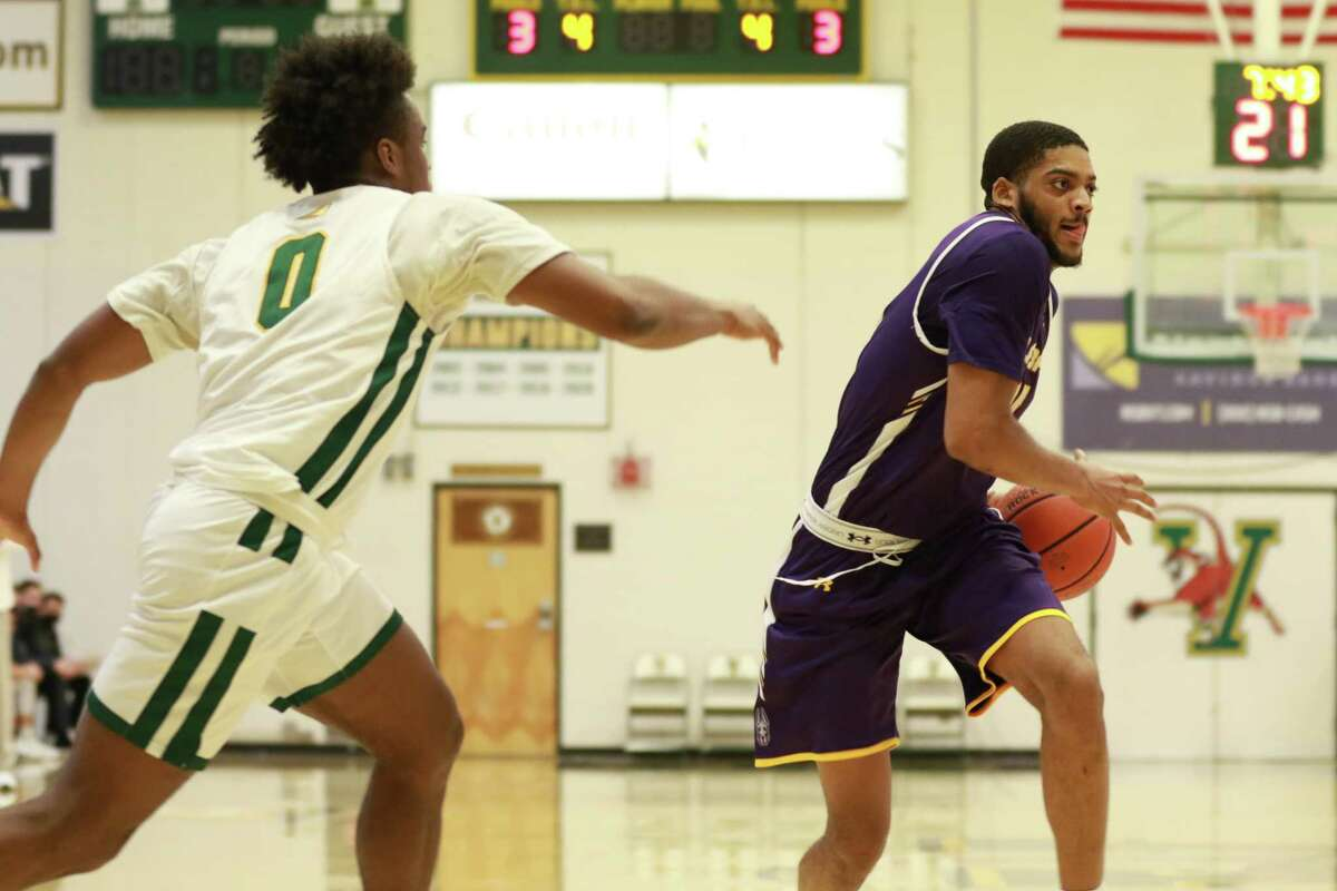 Jarvis Doles, who started the past two games against Vermont, is shown in the game on Saturday, Jan. 2, in which he scored eight of his 10 points in the second half in UAlbany's 63-62 win over the Catamounts. (Nich Hall/UVM athletics)