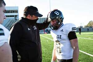 Coach Steve Driffill talks to Steele player Wyatt Begeal (8) after their loss to Westlake at their 6A Division I state quarterfinals UIL football game at the Kelly Reeves Athletic Complex on January 2, 2021 in Round Rock, Texas.
