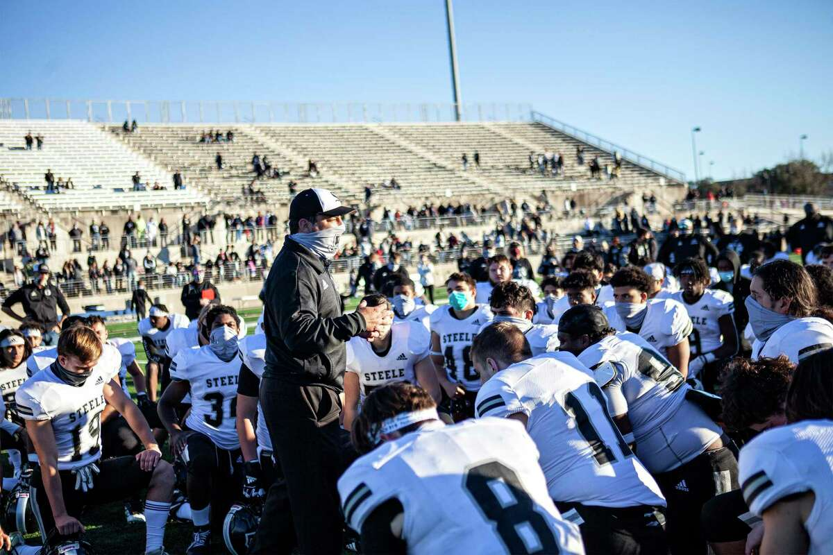 Steele Coach David Saenz speaks to his team after their loss to Westlake at their 6A Division I state quarterfinals UIL football game at the Kelly Reeves Athletic Complex on January 2, 2021 in Round Rock, Texas.