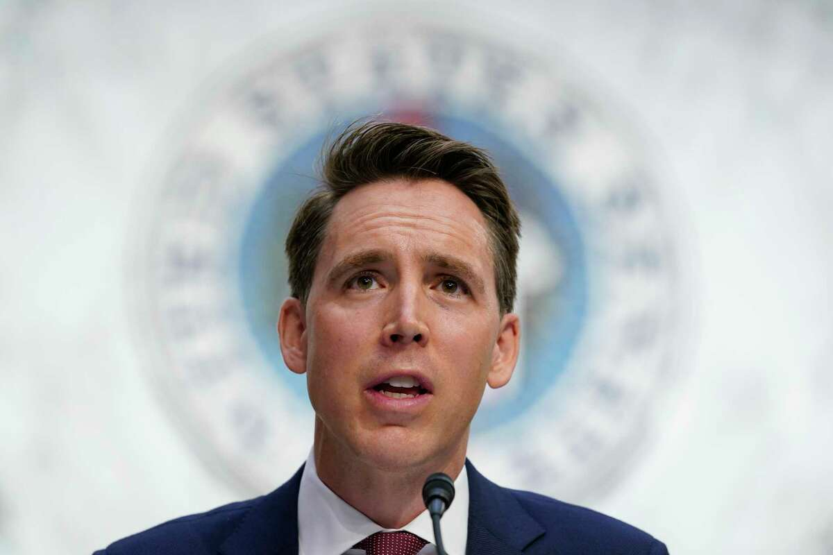 FILE - In this Oct. 12, 2020, file photo Sen. Josh Hawley, R-Mo., speaks during a confirmation hearing for Supreme Court nominee Amy Coney Barrett before the Senate Judiciary Committee on Capitol Hill in Washington. Hawley, says he will raise objections next week when the Congress meets to affirm President-elect Joe Biden's victory in the election, forcing House and Senate votes that are likely to delay - but in no way alter - the final certification of Biden's win.(AP Photo/Susan Walsh, Pool, File)