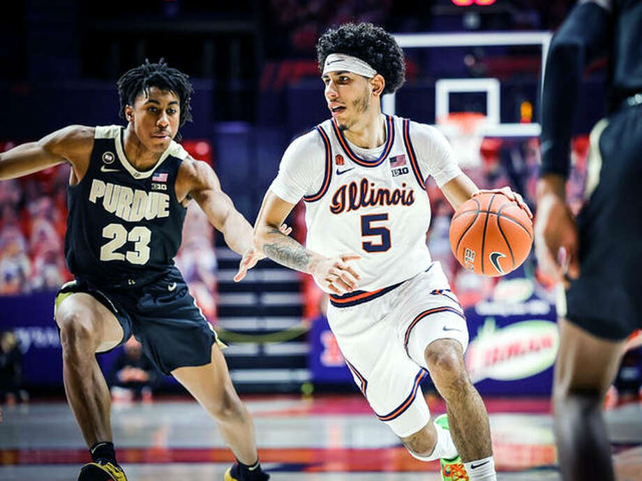 Andre Curbelo of Illinois (5) controls the ball while being guarded by Purdue's Jaden Ivy Saturday night at the State Farm Center in Champaign. Curbelo, a freshman, dished out six assists and scored eight points to help the Illini to a 66-58 victory. Photo: Andy Wenstrand | Illinois Athletics