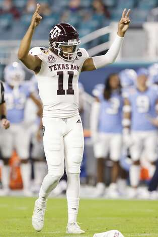 MIAMI GARDENS, FLORIDA - JANUARY 02: Kellen Mond #11 of the Texas A&M Aggies celebrates a nine-yard touchdown run by Isaiah Spiller #28 (not pictured) against the North Carolina Tar Heels during the first half of the Capital One Orange Bowl at Hard Rock Stadium on January 02, 2021 in Miami Gardens, Florida. (Photo by Michael Reaves/Getty Images) Photo: Michael Reaves/Getty Images / 2021 Getty Images