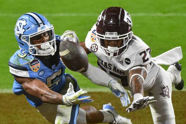 MIAMI GARDENS, FL - JANUARY 02: Dazz Newsome #5 of the North Carolina Tar Heels catches a touchdown pass during the second quarter against the Texas A&M Aggies at Hard Rock Stadium on January 2, 2021 in Miami Gardens, Florida. (Photo by Eric Espada/Getty Images) Photo: Eric Espada/Getty Images / 2021 Getty Images