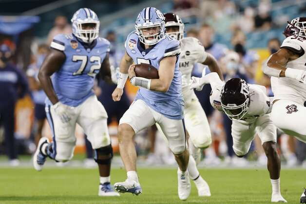 MIAMI GARDENS, FLORIDA - JANUARY 02: Sam Howell #7 of the North Carolina Tar Heels scrambles with the ball against the Texas A&M Aggies during the first half of the Capital One Orange Bowl at Hard Rock Stadium on January 02, 2021 in Miami Gardens, Florida. (Photo by Michael Reaves/Getty Images) Photo: Michael Reaves/Getty Images / 2021 Getty Images