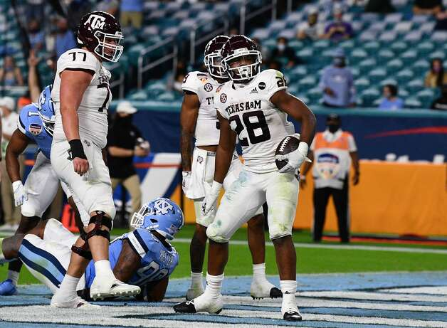 MIAMI GARDENS, FLORIDA - JANUARY 02: Isaiah Spiller #28 of the Texas A&M Aggies scores his second touchdown against the North Carolina Tar Heels in the second quarter of the Capital One Orange Bowl at Hard Rock Stadium on January 02, 2021 in Miami Gardens, Florida. (Photo by Mark Brown/Getty Images) Photo: Mark Brown/Getty Images / 2021 Getty Images