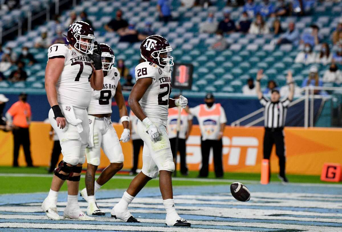 MIAMI GARDENS, FLORIDA - JANUARY 02: Isaiah Spiller #28 of the Texas A&M Aggies celebrates scoring a touchdown against the North Carolina Tar Heels in the second quarter of the Capital One Orange Bowl at Hard Rock Stadium on January 02, 2021 in Miami Gardens, Florida. (Photo by Mark Brown/Getty Images)