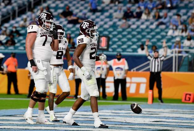MIAMI GARDENS, FLORIDA - JANUARY 02: Isaiah Spiller #28 of the Texas A&M Aggies celebrates scoring a touchdown against the North Carolina Tar Heels in the second quarter of the Capital One Orange Bowl at Hard Rock Stadium on January 02, 2021 in Miami Gardens, Florida. (Photo by Mark Brown/Getty Images) Photo: Mark Brown/Getty Images / 2021 Getty Images