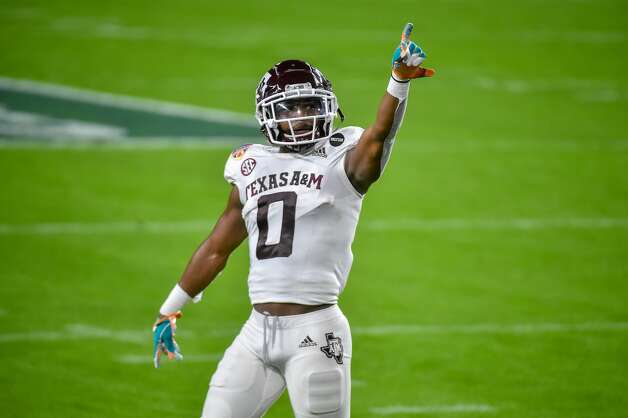 MIAMI GARDENS, FL - JANUARY 02: Ainias Smith #0 of the Texas A&M Aggies points to fans during warmups before the start of the game against the North Carolina Tar Heels at Hard Rock Stadium on January 2, 2021 in Miami Gardens, Florida. (Photo by Eric Espada/Getty Images) Photo: Eric Espada/Getty Images / 2021 Getty Images