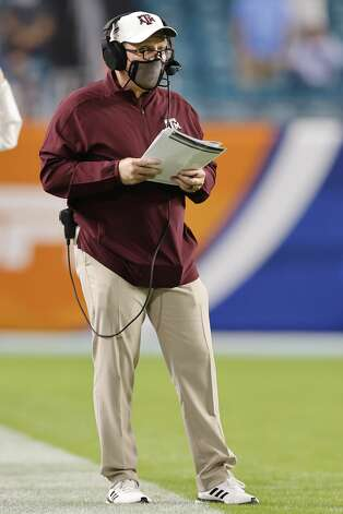 MIAMI GARDENS, FLORIDA - JANUARY 02: Head coach Jimbo Fisher of the Texas A&M Aggies looks on against the North Carolina Tar Heels during the first half of the Capital One Orange Bowl at Hard Rock Stadium on January 02, 2021 in Miami Gardens, Florida. (Photo by Michael Reaves/Getty Images) Photo: Michael Reaves/Getty Images / 2021 Getty Images