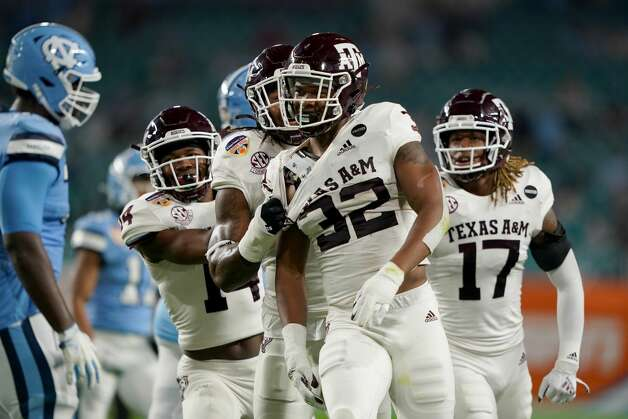 MIAMI GARDENS, FLORIDA - JANUARY 02: Andre White Jr. #32 of the Texas A&M Aggies celebrates an interception against the North Carolina Tar Heels in the first quarter of the Capital One Orange Bowl at Hard Rock Stadium on January 02, 2021 in Miami Gardens, Florida. (Photo by Mark Brown/Getty Images) Photo: Mark Brown/Getty Images / 2021 Getty Images