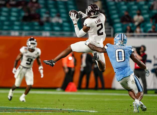 MIAMI GARDENS, FLORIDA - JANUARY 02: Chase Lane #2 of the Texas A&M Aggies catches a pass against Ja'Qurious Conley #0 of the North Carolina Tar Heels in the second quarter of the Capital One Orange Bowl at Hard Rock Stadium on January 02, 2021 in Miami Gardens, Florida. (Photo by Mark Brown/Getty Images) Photo: Mark Brown/Getty Images / 2021 Getty Images