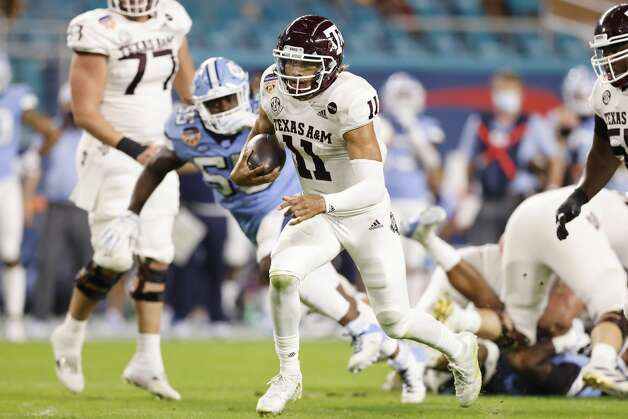 MIAMI GARDENS, FLORIDA - JANUARY 02: Kellen Mond #11 of the Texas A&M Aggies runs with the ball against the North Carolina Tar Heels during the first half of the Capital One Orange Bowl at Hard Rock Stadium on January 02, 2021 in Miami Gardens, Florida. (Photo by Michael Reaves/Getty Images) Photo: Michael Reaves/Getty Images / 2021 Getty Images