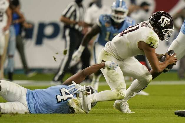 North Carolina defensive back Trey Morrison (4) sacks Texas A&M quarterback Kellen Mond (11) during the first half of the Orange Bowl NCAA college football game Saturday, Jan. 2, 2021, in Miami Gardens, Fla. (AP Photo/Lynne Sladky) Photo: Lynne Sladky/Associated Press / AP