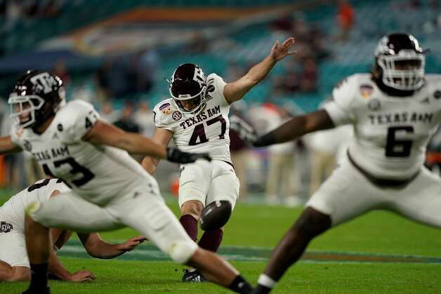MIAMI GARDENS, FLORIDA - JANUARY 02: Seth Small #47 of the Texas A&M Aggies kicks a field goal against the North Carolina Tar Heels in the second quarter of the Capital One Orange Bowl at Hard Rock Stadium on January 02, 2021 in Miami Gardens, Florida. (Photo by Mark Brown/Getty Images) Photo: Mark Brown/Getty Images / 2021 Getty Images