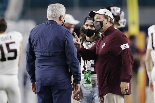 MIAMI GARDENS, FLORIDA - JANUARY 02: Head coach Mack Brown of the North Carolina Tar Heels talks with head coach Jimbo Fisher of the Texas A&M Aggies prior to the Capital One Orange Bowl at Hard Rock Stadium on January 02, 2021 in Miami Gardens, Florida. (Photo by Michael Reaves/Getty Images) Photo: Michael Reaves/Getty Images / 2021 Getty Images