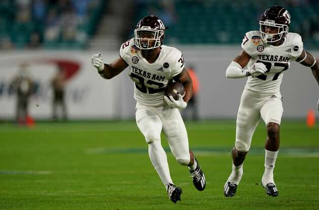 MIAMI GARDENS, FLORIDA - JANUARY 02: Andre White Jr. #32 of the Texas A&M Aggies intercepts the ball against the North Carolina Tar Heels in the first quarter of the Capital One Orange Bowl at Hard Rock Stadium on January 02, 2021 in Miami Gardens, Florida. (Photo by Mark Brown/Getty Images) Photo: Mark Brown/Getty Images / 2021 Getty Images