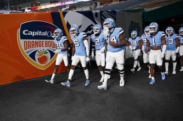 MIAMI GARDENS, FLORIDA - JANUARY 02: North Carolina Tar Heels take to the field prior to the game against the Texas A&M Aggies during the Capital One Orange Bowl at Hard Rock Stadium on January 02, 2021 in Miami Gardens, Florida. (Photo by Mark Brown/Getty Images) Photo: Mark Brown/Getty Images / 2021 Getty Images