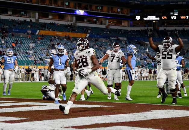 MIAMI GARDENS, FLORIDA - JANUARY 02: Isaiah Spiller #28 of the Texas A&M Aggies runs for a touchdown against the North Carolina Tar Heels in the first quarter of the Capital One Orange Bowl at Hard Rock Stadium on January 02, 2021 in Miami Gardens, Florida. (Photo by Mark Brown/Getty Images) Photo: Mark Brown/Getty Images / 2021 Getty Images