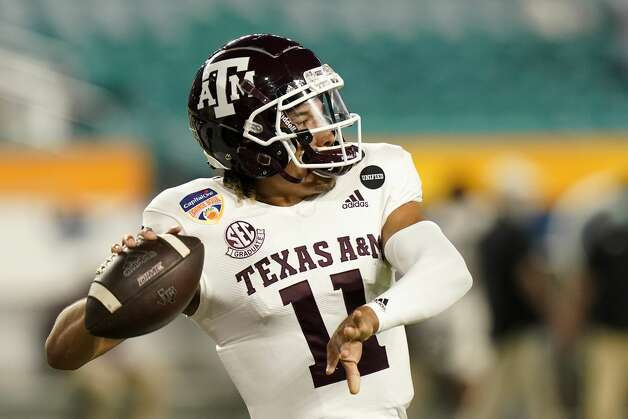 Texas A&M quarterback Kellen Mond (11) warms up before the Orange Bowl NCAA college football game against North Carolina, Saturday, Jan. 2, 2021, in Miami Gardens, Fla.(AP Photo/Lynne Sladky) Photo: Lynne Sladky/Associated Press / Copyright 2021 The Associated Press. All rights reserved.
