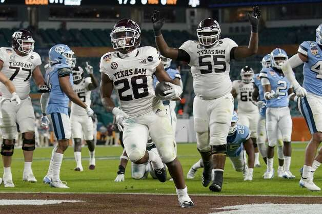 Texas A&M running back Isaiah Spiller (28) runs to score a touchdown during the first half of the Orange Bowl NCAA college football game against North Carolina, Saturday, Jan. 2, 2021, in Miami Gardens, Fla.(AP Photo/Lynne Sladky) Photo: Lynne Sladky/Associated Press / Copyright 2021 The Associated Press. All rights reserved.